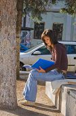 Girl Reading Outdoor poster