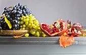 Blue And Green Grapes With Pomegranate poster