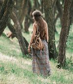 Attractive Hippie Girl Walking Through The Forest poster