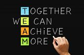 Hand Writing Team Together We Can Achieve More With White Chalk On Blackboard. Teamwork, Synergy Or  poster