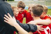 Happy Children Making Sport. Group Of Happy Boys Making Sports Huddle. Smiling Kids Standing Togethe poster