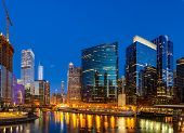 Panorama shot of City of Chicago downtown and Chicago River sunset night in Chicago Illinois USA. poster