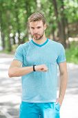 Wrist Band Gadget. Athlete Check Fitness Tracker Nature Background. Athlete With Bristle Looks At Pe poster