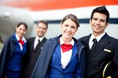 pic of cabin crew  - Portrait of an airplane cabin crew smiling - JPG