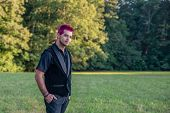 Alternative Diverse Male - Black Clothes, Pink Hair Smirking At Camera. poster