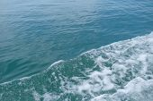 Trail On The Water From The Boat, Sea Waves Bubble Foam From Boat. Stock Photo Image Of Ocean Waves  poster