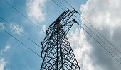 Bottom View Of A High-voltage Electricity Pylon Against Blue Sky With Clouds At Sunny Day. High-volt poster