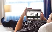 Movie, Video And Online Streaming Service In Tablet. Man Choosing And Watching Digital Film With Sma poster