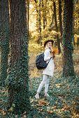 Female Autumn Fashion Concept. Woman Happy Autumn. Autumn And Leaf Fall Dreams. Autumn Time For Fash poster