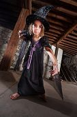 picture of sceptre  - Serious female European child witch pointing her magic staff - JPG