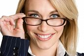 picture of blue eyes  - Pretty young blonde businesswoman wearing eye glasses - JPG