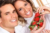 stock photo of healthy eating girl  - Young love couple eating strawberries - JPG
