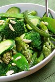 stock photo of green bean  - Serving bowl of mixed green vegetables topped with toasted almonds - JPG