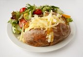 picture of butter-lettuce  - A Cheddar cheese baked potato on a plate with side salad - JPG