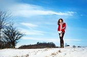 image of gril  - Beautiful gril with the curly hair in the snow country - JPG