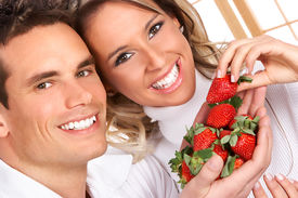 picture of healthy eating girl  - Young love couple eating strawberries - JPG