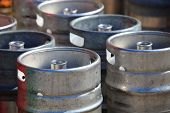 stock photo of brew  - Lots of metal barrels beer kegs at factory brewery