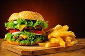 pic of hamburger  - still life with traditional hamburger and french fries - JPG