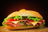stock photo of deli  - still life with traditional homemade deli sub sandwich - JPG