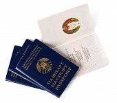 stock photo of passport cover  - four belarusian passports  on a white background - JPG