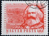 A stamp printed in Hungary shows image of Karl Marx famous communism sociologist