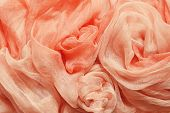 picture of rayon  - Peach silk drapery with chaotic arrangement for background - JPG