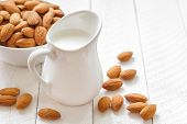 stock photo of edible  - Almond milk in a jug and fruits - JPG