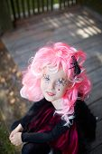picture of antichrist  - Portrait of cute girl in Halloween costume and pink wig looking at camera - JPG