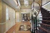 stock photo of entryway  - Foyer with floor design and view into dining room - JPG
