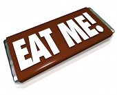 stock photo of eat me  - The words Eat Me on a chocolate candy bar wrapper to encourage you to indulge in a snack - JPG