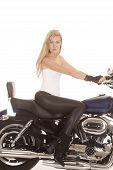 stock photo of black pants  - A woman sittingon a motorbike in her tight fitting black pants - JPG