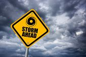 stock photo of waterspout  - Storm warning road sign over gloomy sky - JPG