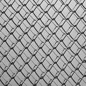 pic of chain link fence  - Obsolete gray grunge concrete closed with chain link fence and shadows - JPG