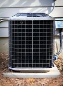 pic of air compressor  - Residential Air Conditioner and Heat pump compressor unit on side of house  - JPG