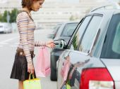 stock photo of car key  - woman with shopping bags holding car keys - JPG