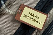 foto of personal safety  - Travel insurance tag tied to a luggage - JPG