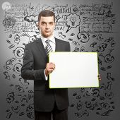 Business man holding empty write board in his hands