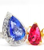 stock photo of diamond ring  - Diamond ring with ruby and sapphire in white background - JPG
