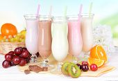 picture of fruit shake  - Milk shakes with fruits on table on light blue background - JPG