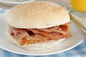 picture of bap  - Bacon Sandwich or bacon butty selective focus on the bacon - JPG