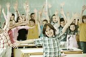 image of youngster  - Cheerful group of kids at school room having education activity - JPG