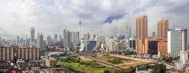 stock photo of klcc  - Kuala Lumpur Malaysia Central Cityscape with Old Neighborhood Houses Against Cloudy Blue Sky Panorama - JPG