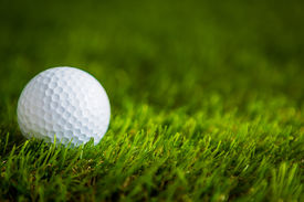 picture of caddy  - Golf ball on green grass - JPG