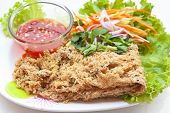 foto of catfish  - crispy catfish spicy salad with mango and sweet sauce Thaifood. ** Note: Shallow depth of field - JPG