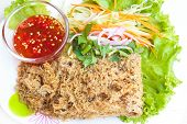 foto of catfish  - crispy catfish spicy salad with mango and sweet sauce Thaifood.