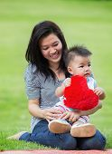 picture of mums  - Beautiful asia Mother And Baby outdoors - JPG