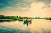 pic of canoe boat man  - Two Caucasian Men In A Canoe In Beautiful Nature - JPG