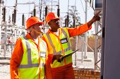 foto of substation  - successful electrical engineers taking machine readings in substation - JPG