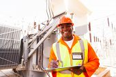 stock photo of substation  - cheerful african electricity company substation worker - JPG