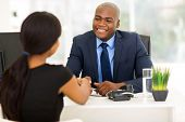 picture of black american  - successful african american businessman handshaking with client in office - JPG